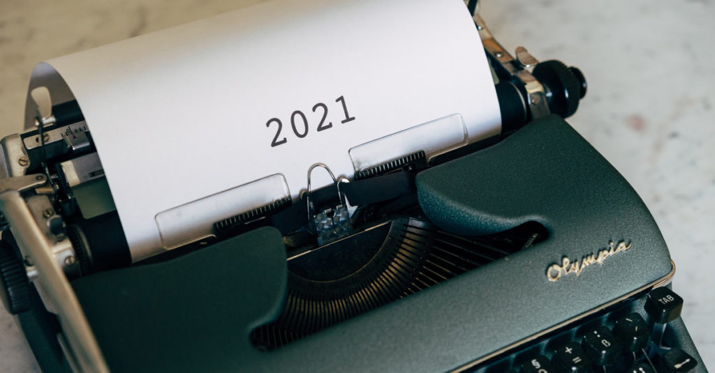 Old fashioned typewriter with 2021 typed on white paper