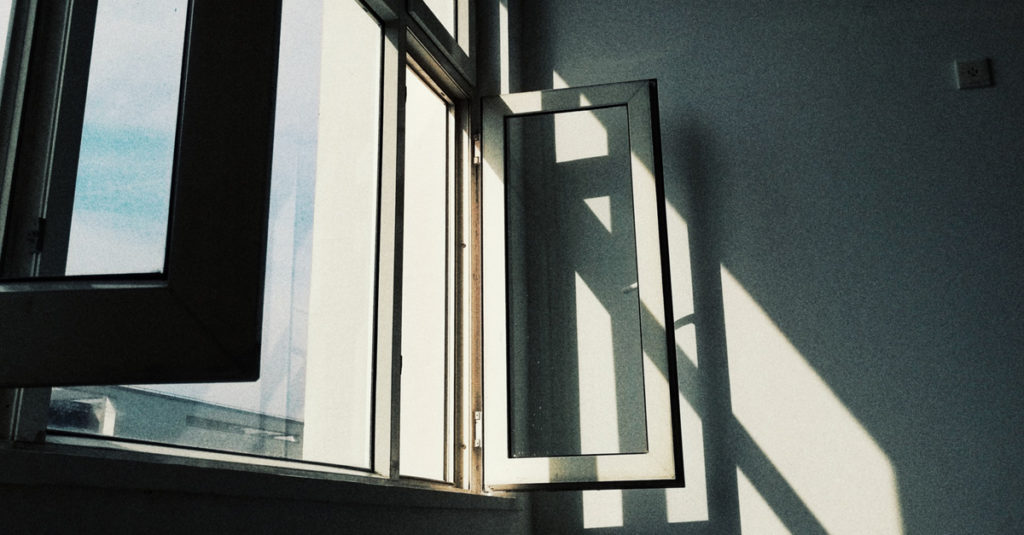 Image of open windows with sunlight streaming in